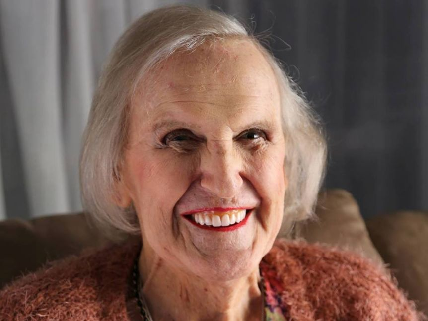 Smiling older woman with red lipstick