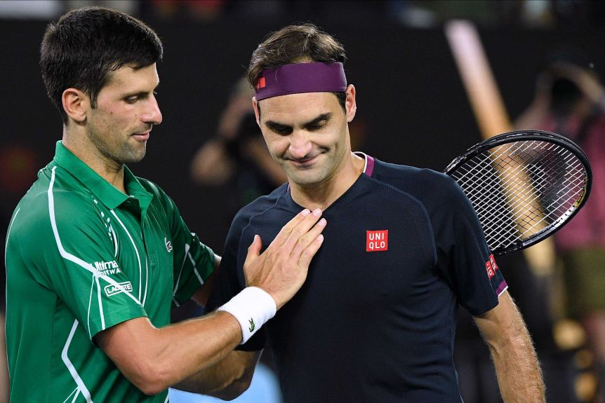 Two male tennis players congratulate each other at the net after their Australian Open tennis match.