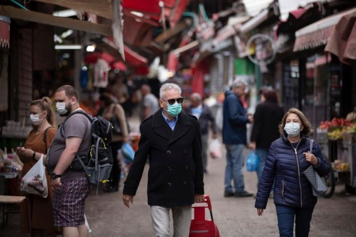 People at a market space with face masks.