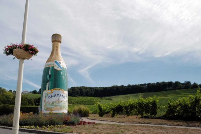 A Champagne advert is displayed at the entrance of the village in Avize, in the Champagne region.