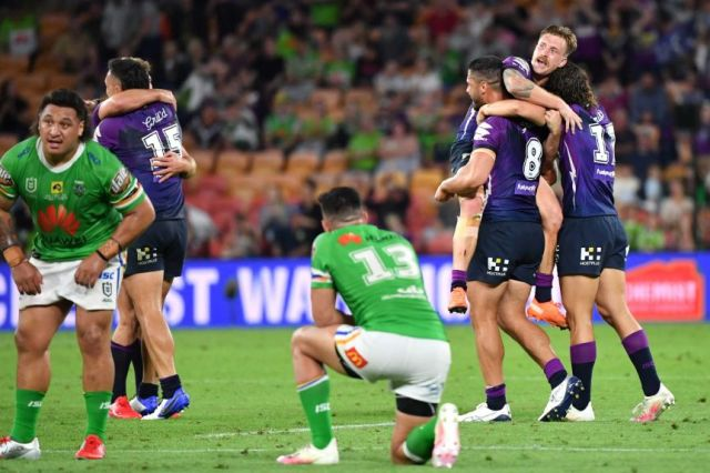 Storm players celebrate while Raiders players look down-trodden.