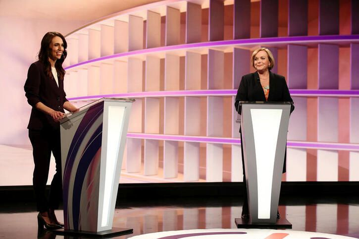 New Zealand Prime Minister Jacinda Ardern (L) and National leader Judith Collins participate in a televised debate.