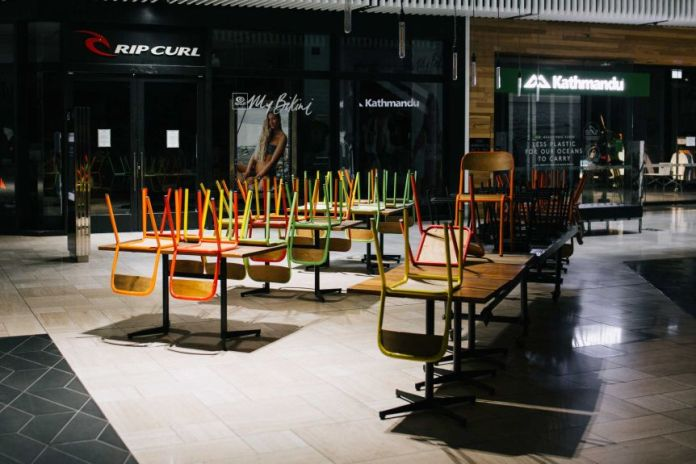 A photo of chairs on top of tables in a Melbourne mall restaurant.