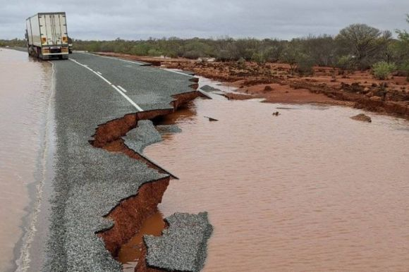 Eroded road almost gone from floodwaters.