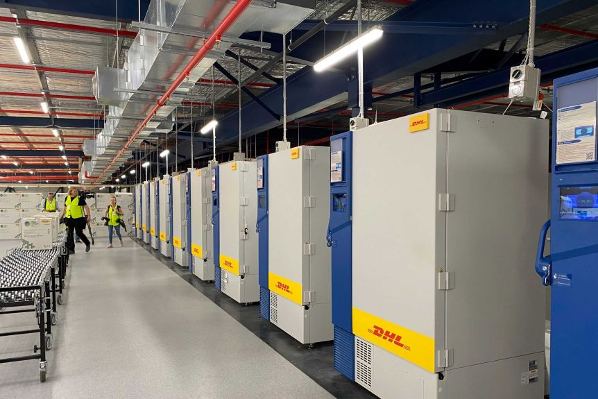 Freezers in a row inside a modern-looking warehouse.