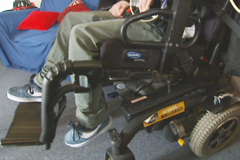 Wheelchair with unidentified adolescent