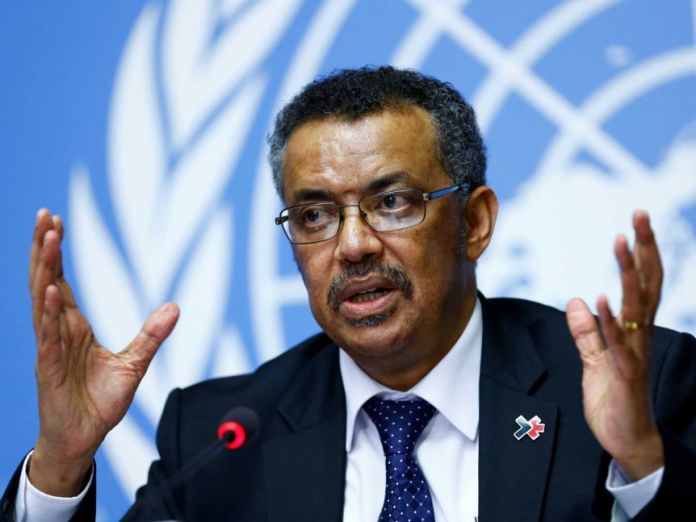 Tedros Adhanom Ghebreyesus sat in front of the microphone and gestured with his hands.