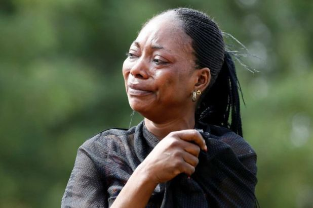 A woman weeps