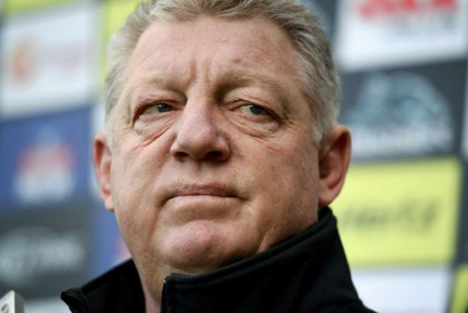 Phil Gould looks to his left.