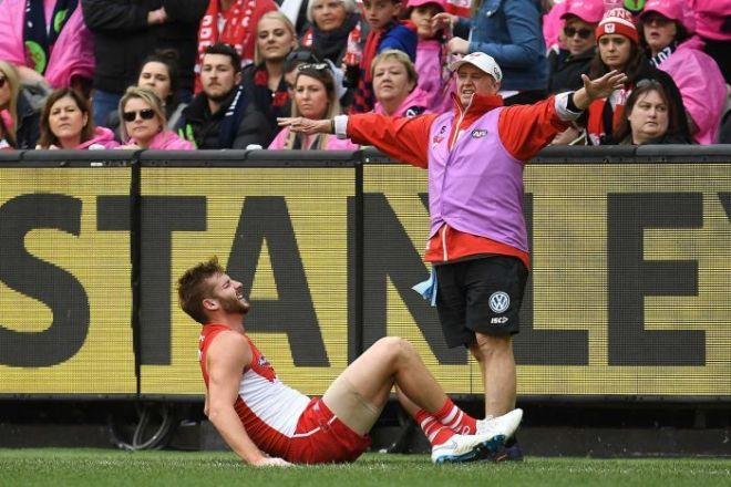 Alex Johnson lies injured on the sideline
