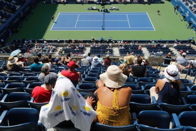Fans watch the match between Caroline Wozniacki and Samantha Stosur at the US Open in New York.