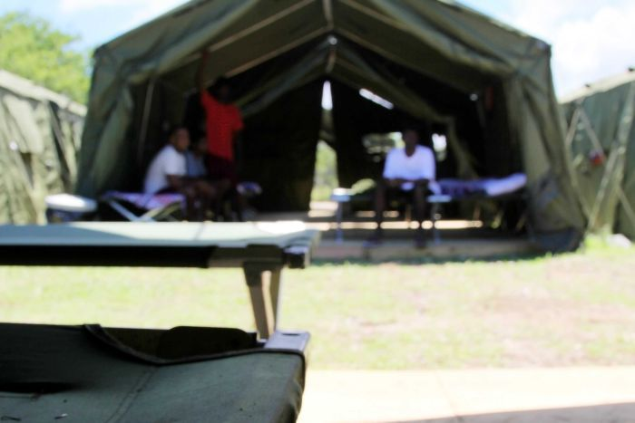 A blurry picture of unidentified people in a tent on Nauru.