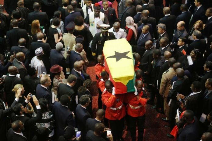 Soldiers carry the coffin of former UN Secretary-General Kofi Annan through a mourning community.