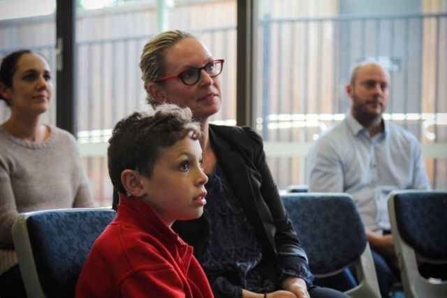 Tyler and mum Philippa Potaka listening intently at the launch.
