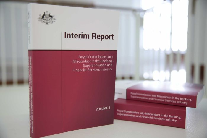 Banking royal commission interim reports on a table.
