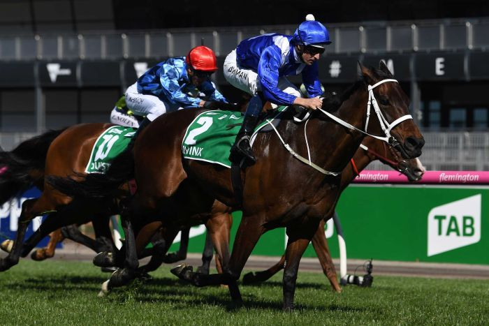 Jockey Hugh Bowman (R) rides Winx to victory in the Turnbull Stakes at Flemington on October 6, 2018.