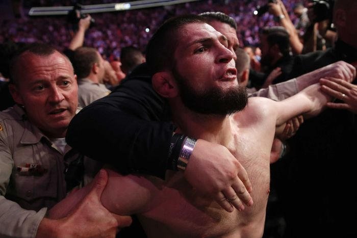 Khabib Nurmagomedov exits the octagon after McGregor brawl