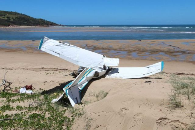 Twisted wreckage of the plane on the beach near Middle Island.