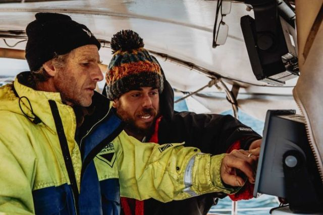 Ross Edgley checks weather and tides data on board his support boat during the Great British Swim.