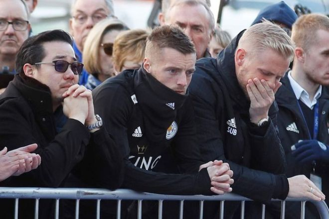 Sad looking Aiyawatt, Jamie Vardy and Kasper Schmeichel