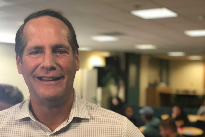 U.S. House of Representatives Candidate Harley Rouda smiles during a rally at the Orange Coast Community College