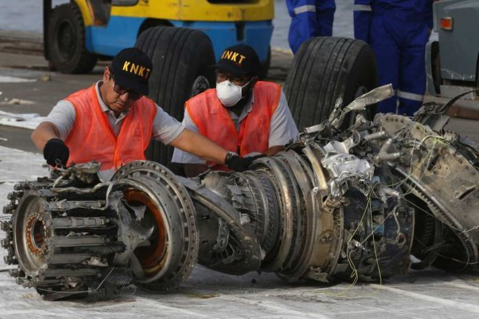 Indonesian investigators inspect machines before Lion Air's deadly flight