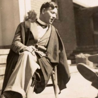 A old photo of a teacher in an academic gown