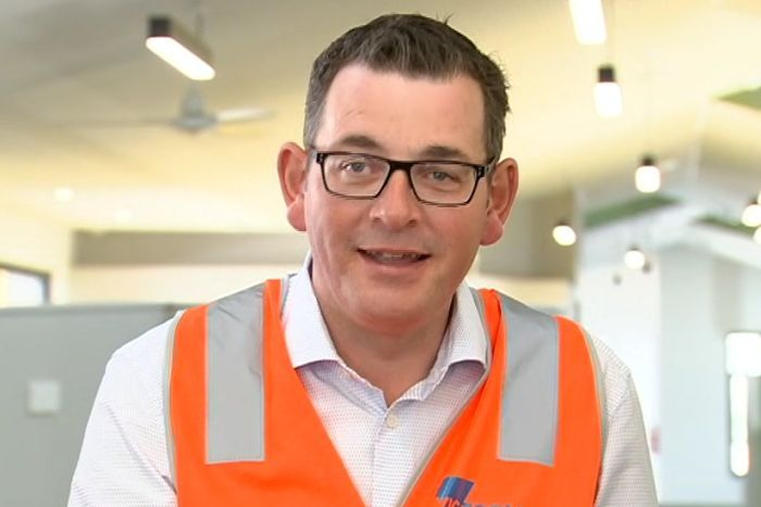 Daniel Andrews speaks to media inside a school which is under construction.