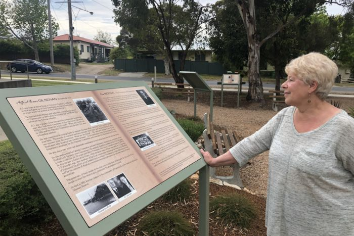 Sandra Hargreaves stands at the Paynesville Cenotaph.