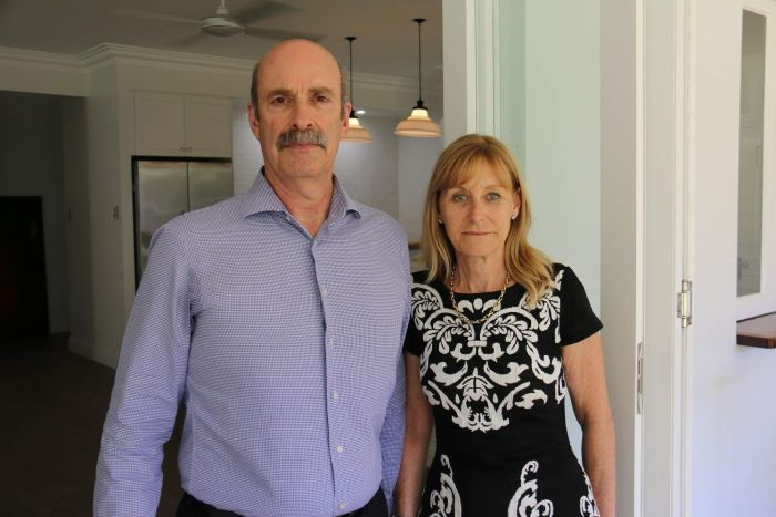 Timothy and Nicki McDavitt standing in front of a set of bifold doors.