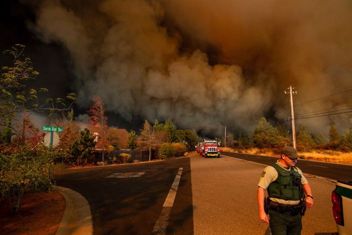 Smoke covered roads as people were forced to flee the fast-moving wildfire on foot.