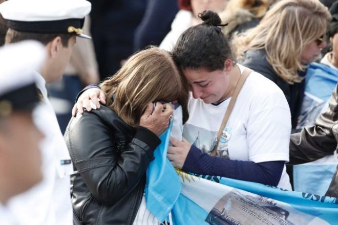 Relatives of the missing crew of the ARA San Juan submarine, embrace in mourning after a remembrance ceremony.