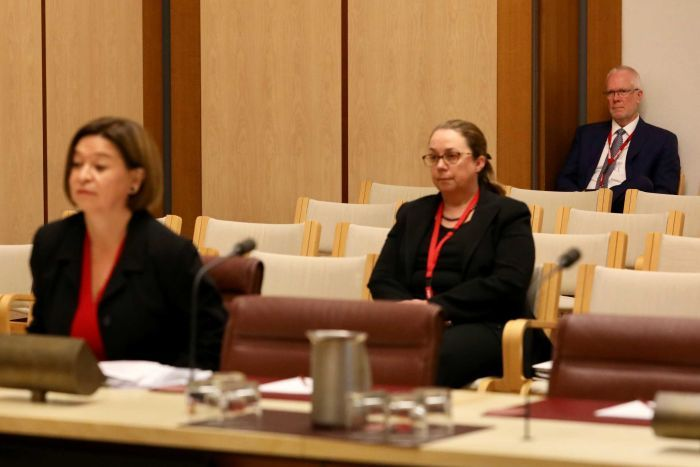 Former chairman Justin Milne watches managing director Michelle Guthrie giving evidence to a Senate inquiry into the ABC.