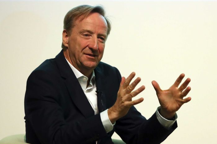 Alex Younger, chief of Britain's spy agency MI6 speaking onstage St Andrews University, Scotland