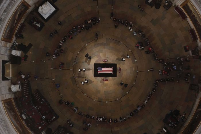 An aerial view shows George HW Bush's coffin lying in the middle of the Capitol Rotunda.