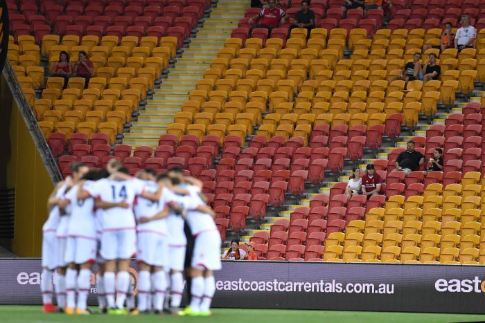 A small crowd watches on at an A-League match in Brisbane.
