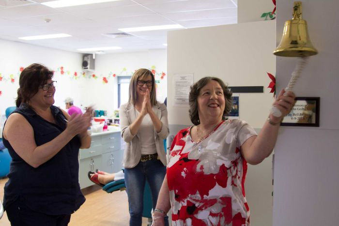 Lynette Morgan rings the bell in the chemotherapy outpatient unit