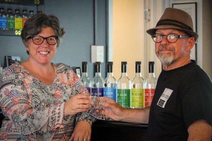 Kate Sinfield and Mark Harris toast at their West Perth bar.