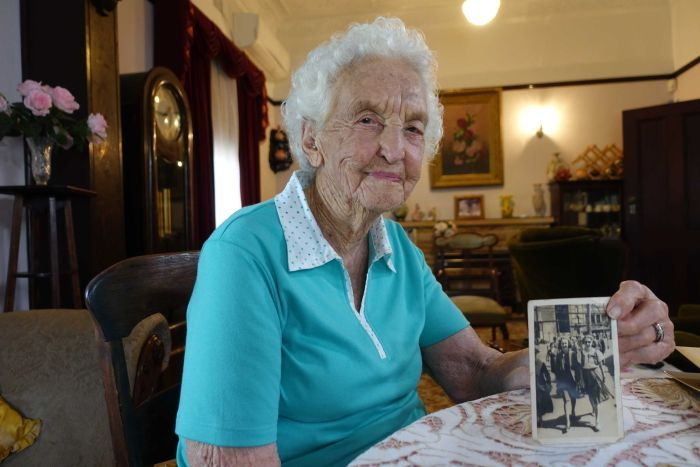 Dorothy Moore, 98, holds a photograph taken in 1936.