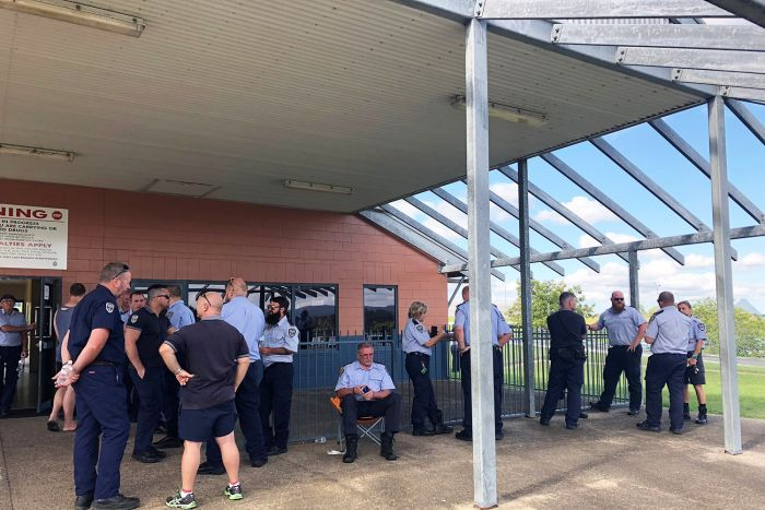 Prison guards gather outside building at Woodford Correctional Centre, north of Brisbane