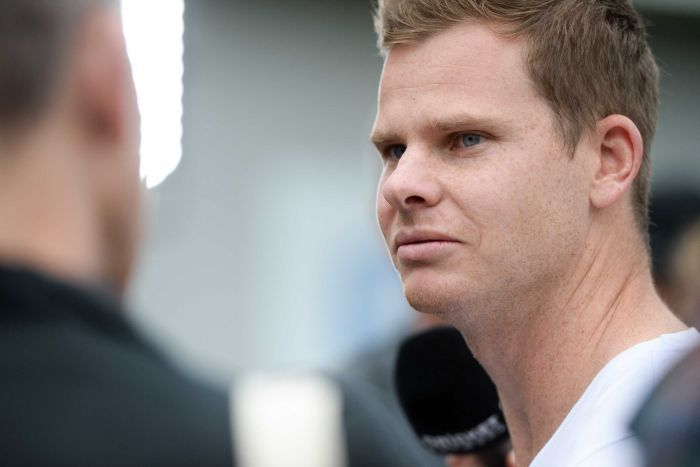 A close-up shot of Steve Smith. wearing casual clothes at a press conference.