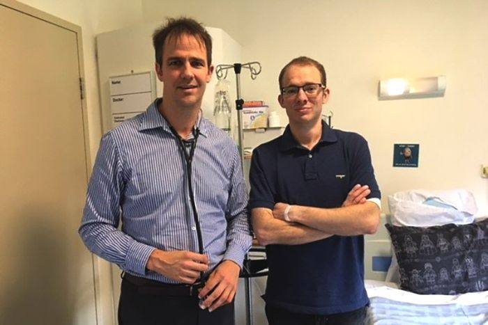 Queensland Lung Transplant Service director Dr Peter Hopkins stands alongside patient Joshua Leveridge