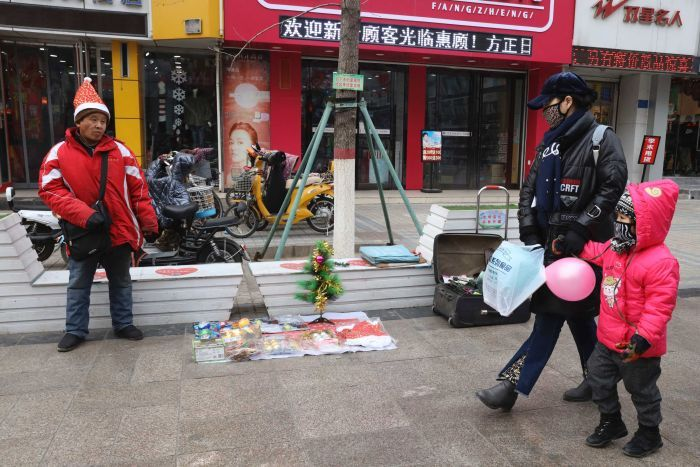 A man sells Christmas decorations on a street of Zhangjiakou in northern China's Hebei province.
