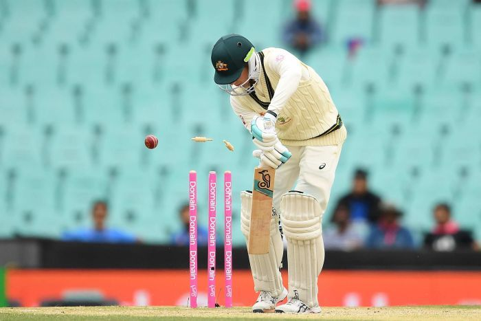Australia batsman Peter Handscomb plays a shot as a cricket ball hits his stumps during a Test against India at the SCG.