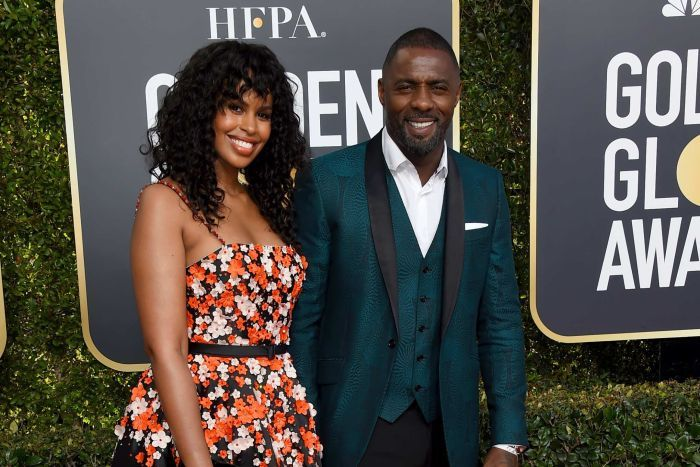Idris Elba, right, and Sabrina Dhowre arrive on the red carpet