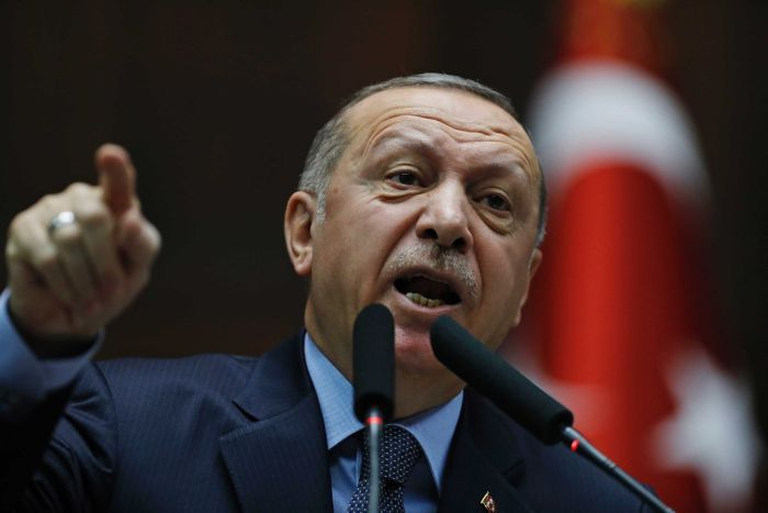 Turkey's President Recep Tayyip Erdogan gestures as he delivers a speech.