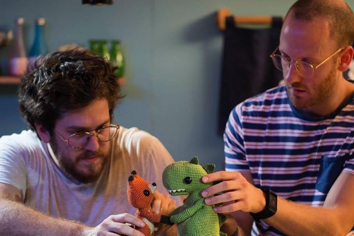 Andrew Goldsmith and Bradley Slabe working with their crochet puppets.