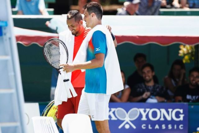 Nick Kyrgios smiles as he chats to Bernard Tomic after their match at the Kooyong Classic on January 9, 2019.