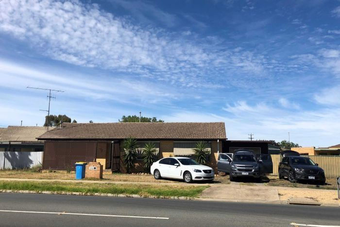 Three cars are seen parked in the driveway of a brick house in Shepparton.