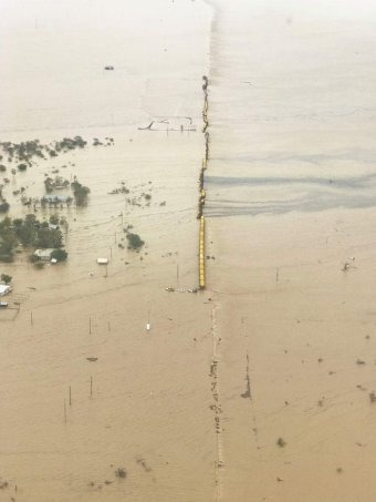 Aerial image of freight train stranded on a flooded plain